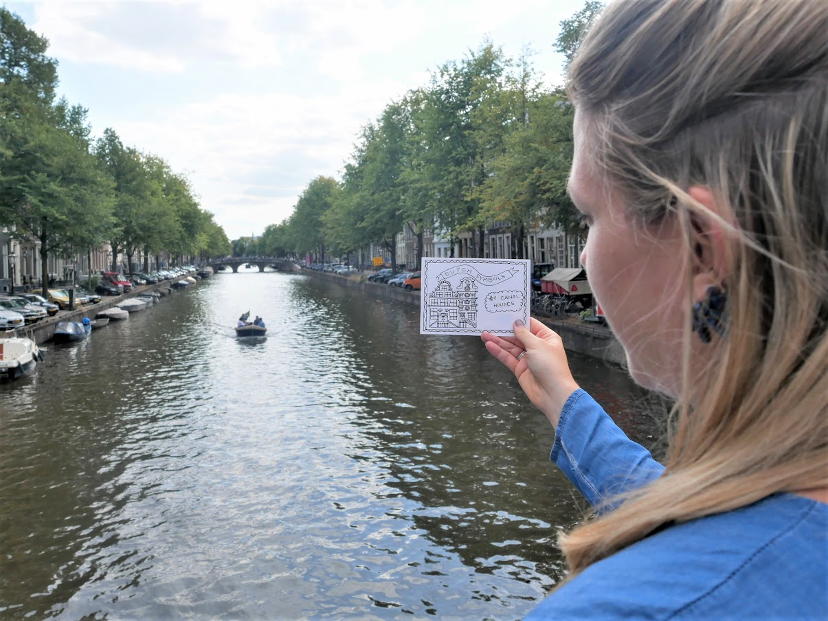 canal in Amsterdam with postcard