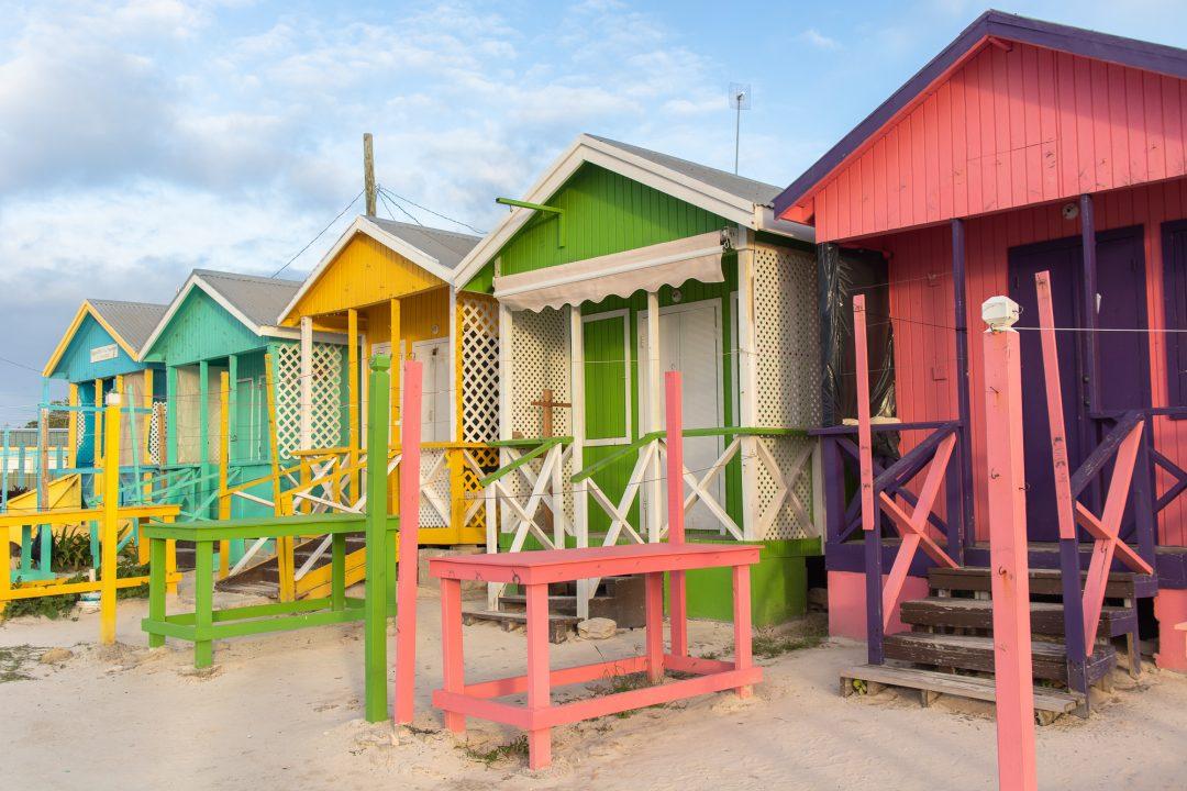 colourful beach huts Antigua