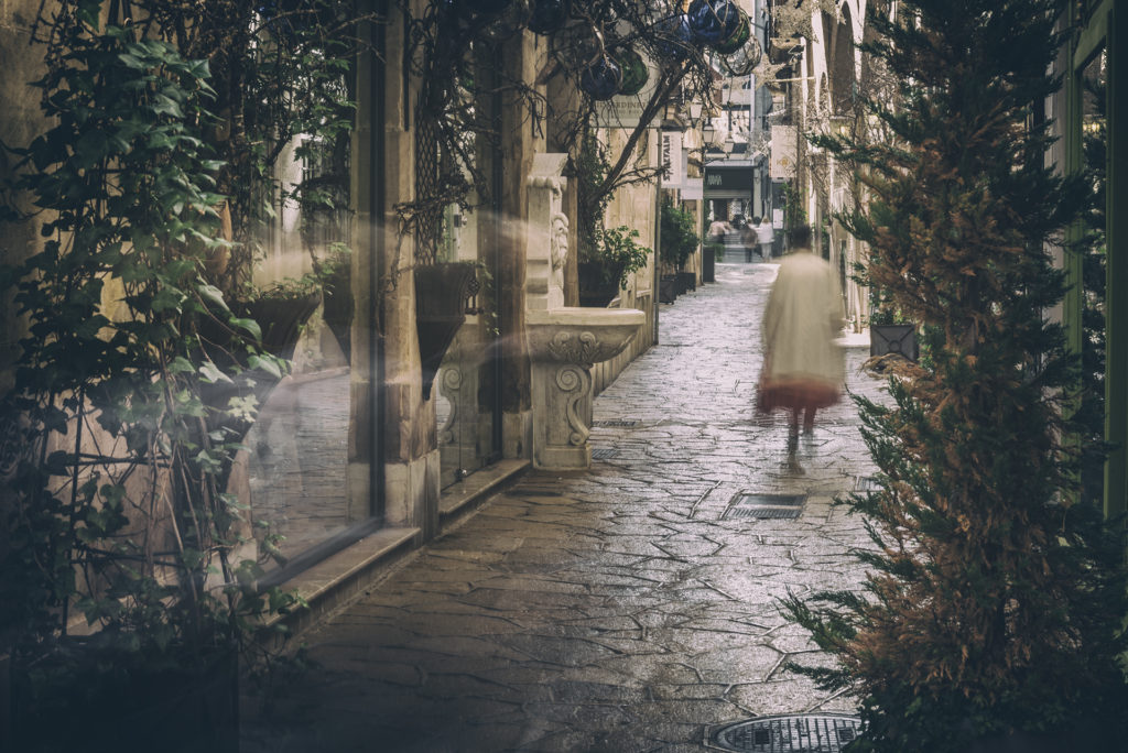 Timelapse image of a lady walking along path in Palma, Mallorca
