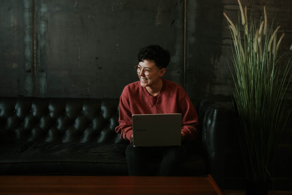 Woman smiling at computer screen