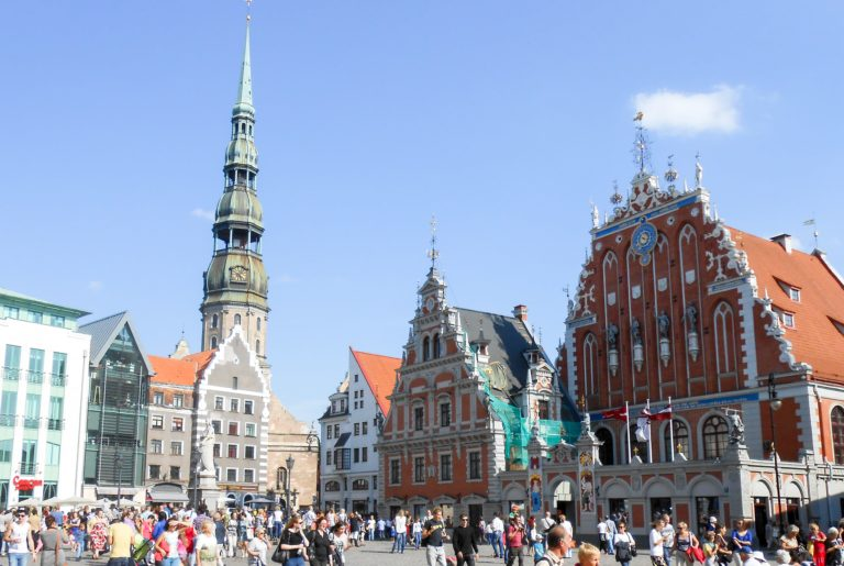 Buildings in the capital of Latvia, Riga - there is a blue sky in the background