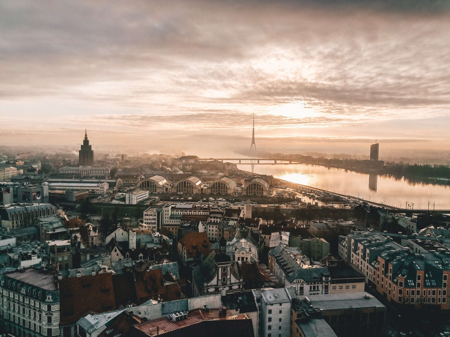 View at sunset across Riga, buildings lit up with golden light