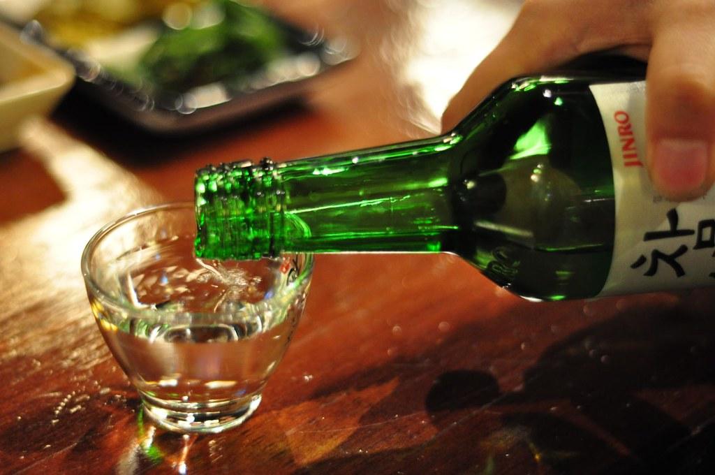 bottle of clear colourless liquid, Soju