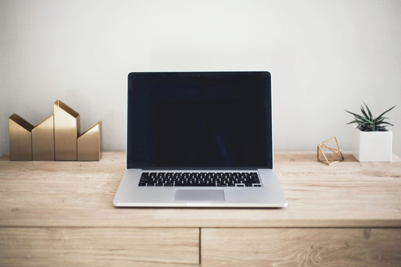 Image of a laptop on a wooden desk