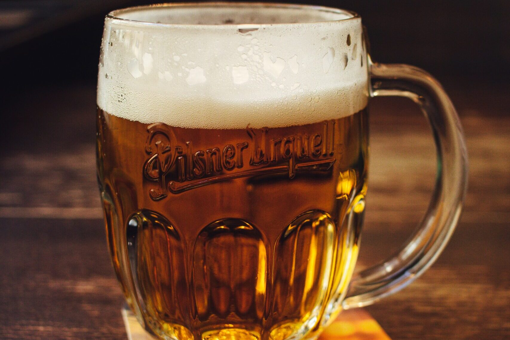Mug of beer with a frothy head